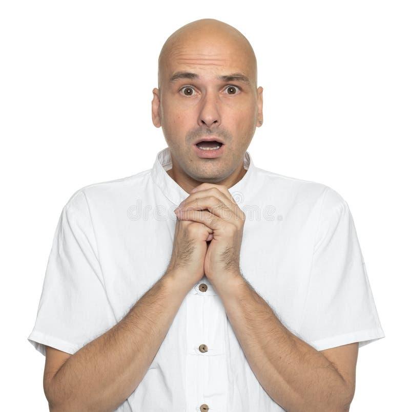 Shocked amazed bald man isolated on white royalty free stock images