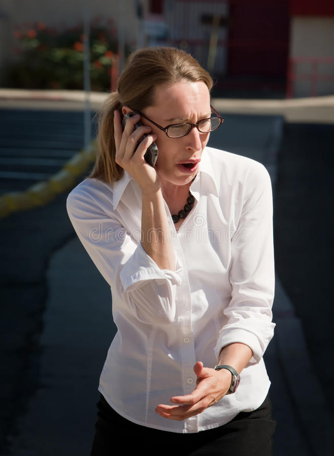 Shocked And Amazed Woman Talks On Cell Phone Royalty Free Stock Photography