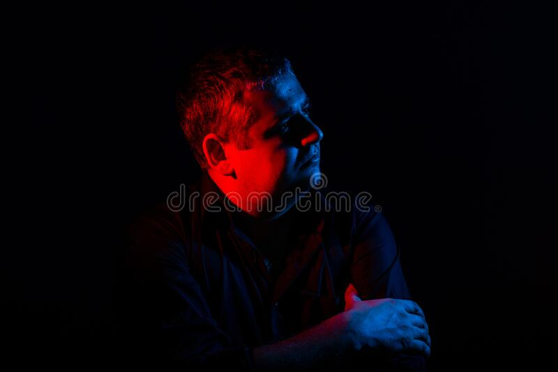 Shocked, astonished, close up. Caucasian man`s portrait on gradient studio background in neon light. Concept of human emotions, royalty free stock photo