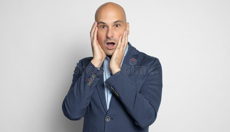 Shocked bald man looking at camera. Isolated stock photos