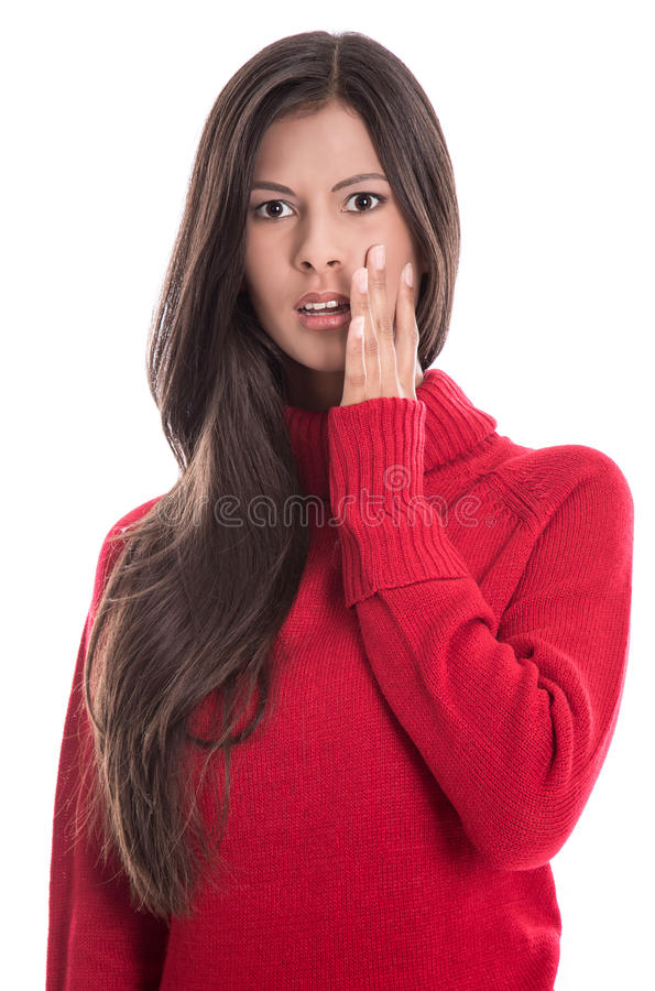 Shocked beautiful brunette in long red jumper isolated on white royalty free stock image