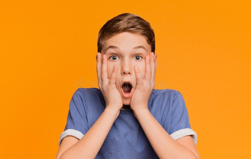 Shocked boy opened his mouth in amazement stock images