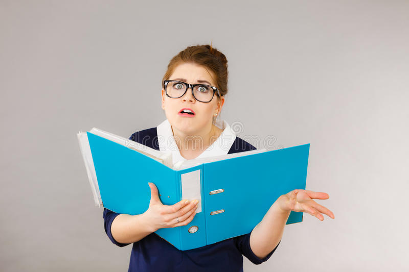 Shocked business woman looking at documents stock image