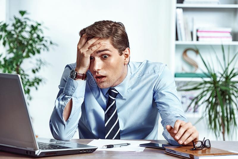 Shocked businessman dissatisfied his earnings. stock photo