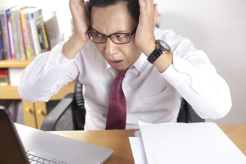 Shocked Businessman Looking at His Laptop, Failure Bad News Concept stock image
