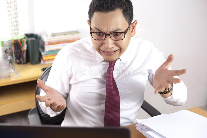 Shocked Businessman Looking at His Laptop, Failure Bad News Concept royalty free stock photography