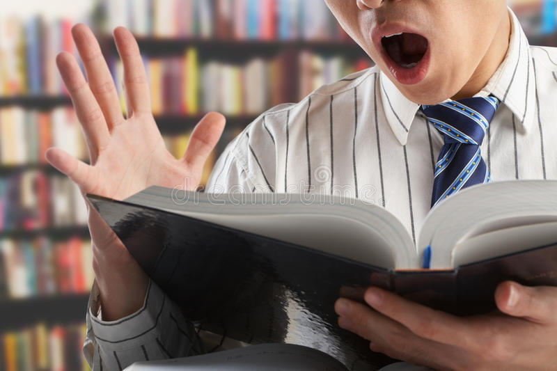 Download Shocked Businessman Or Professor Stock Photo - Image of searching, journal: 14537998