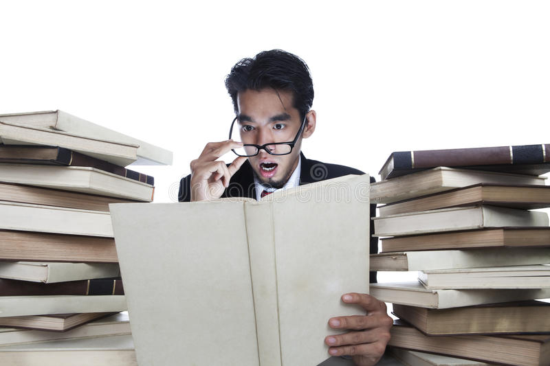 Download Shocked Businessman Reading Books Royalty Free Stock Photos - Image: 23742648
