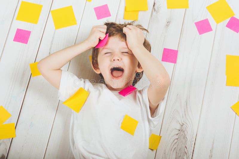 Shocked child with empty stickers on his body. royalty free stock photography