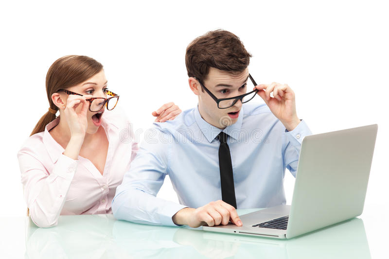 Shocked couple in front of laptop stock photography