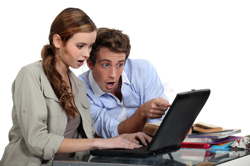 Shocked couple pointing stock photo