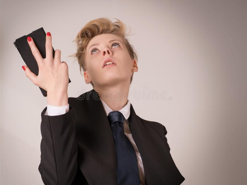 Shocked, disappointed or exhausted business woman holding smart royalty free stock images