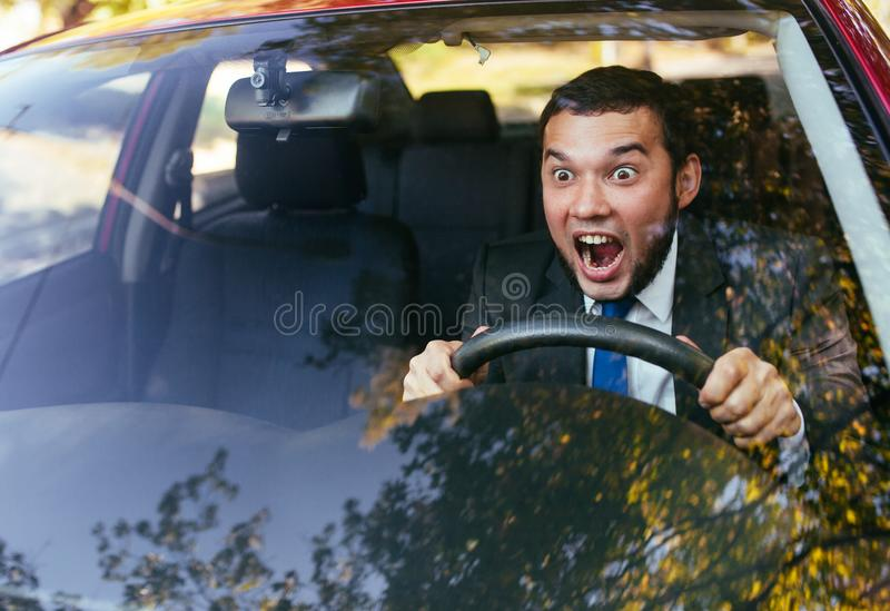 Shocked driver in the car, frightened man driving. Shocked driver in the car stock images