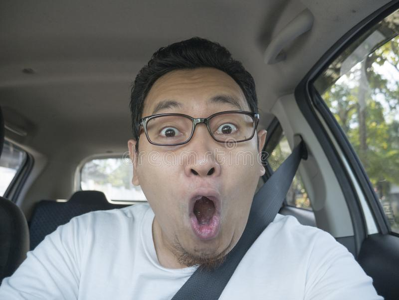 Shocked Driver About To Have Accident. Portrait of male Asian driver shocked and panic about to have crash accident, close up with open mouth indonesian royalty free stock photos