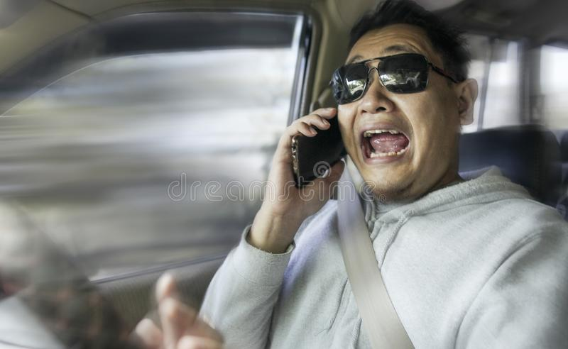 Shocked Driver About To Have Accident. Portrait of male Asian driver shocked and panic about to have crash accident royalty free stock image