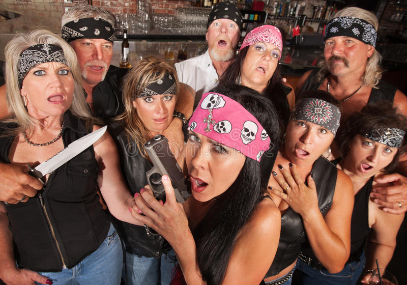 Shocked Gang Members. Shocked crowd of motorcycle gang members with weapons stock photo