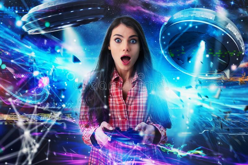 Shocked girl plays with online ufo videogames. Concept of technology and entertainment royalty free stock images