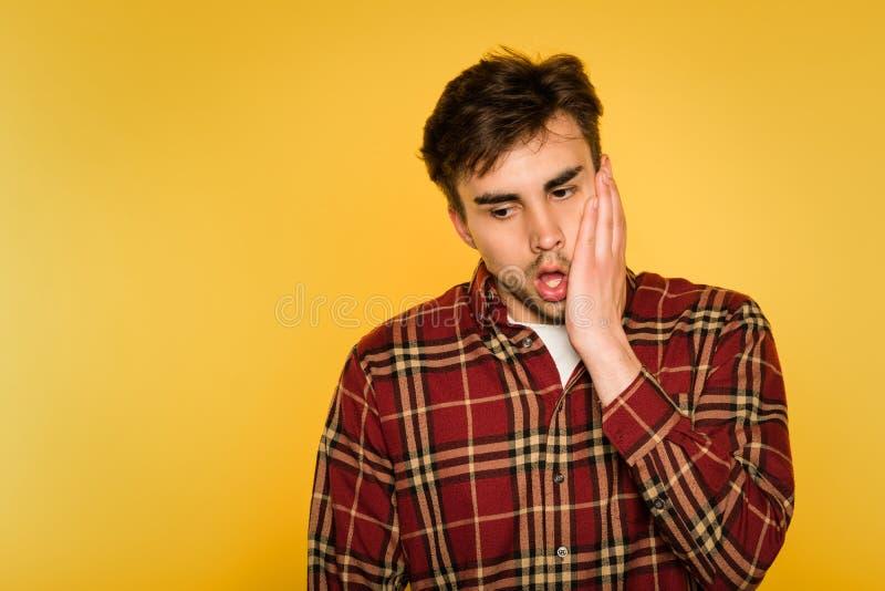 Shocked gobsmacked stressed man clutch face emotion stock photo