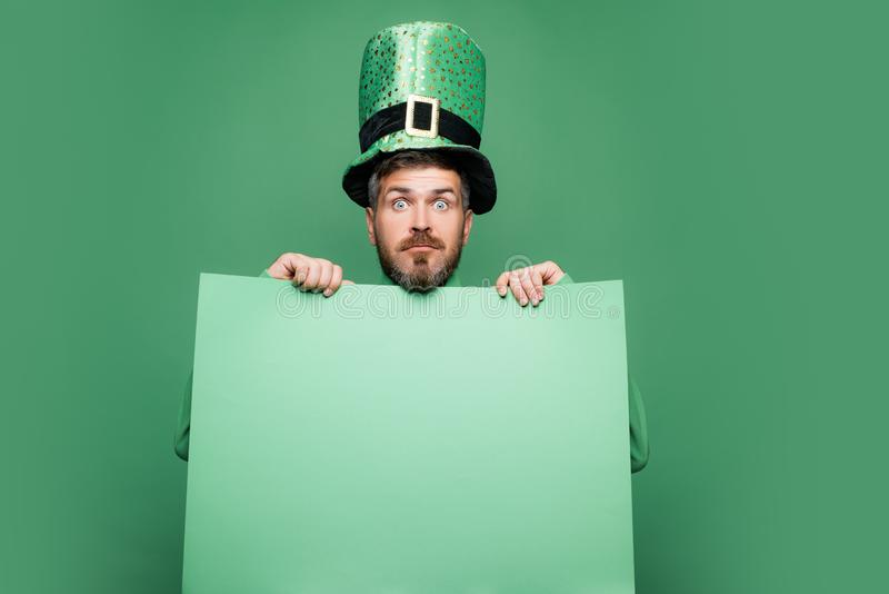 Shocked and happy male face. Happy Saint Patrick`s day. Hipster in leprechaun hat and costume with wide open eyes royalty free stock photos