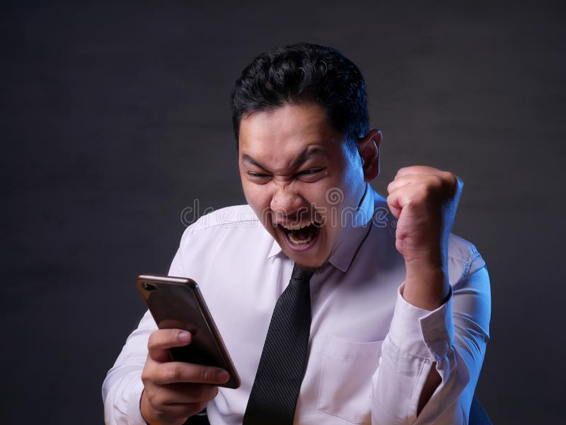 Shocked Happy Man Looking at Smart Phone royalty free stock images