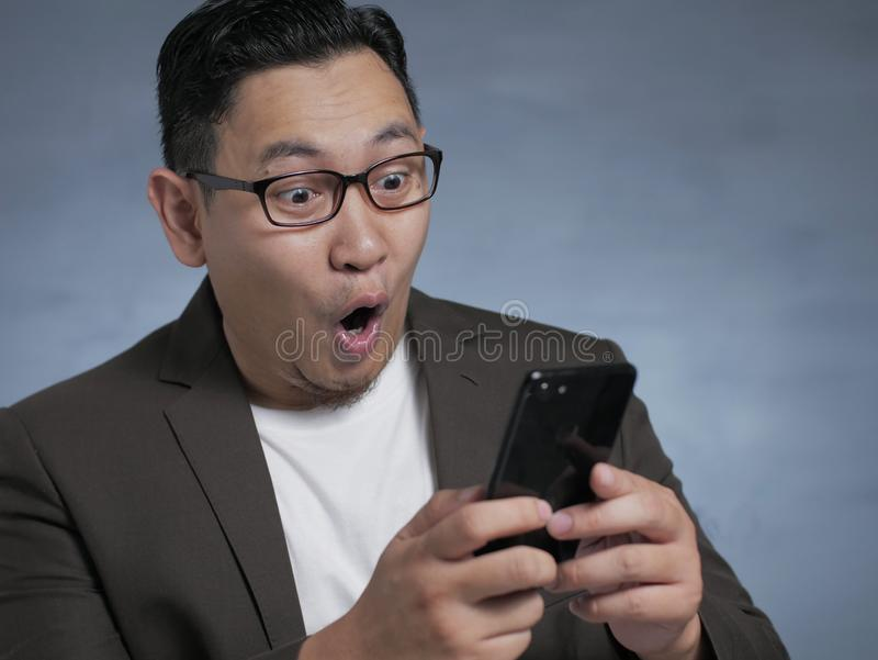 Shocked Happy Man Looking at Smart Phone stock images