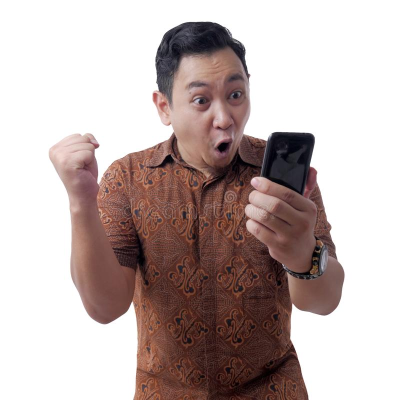 Shocked Happy Man Looking at Smart Phone stock image