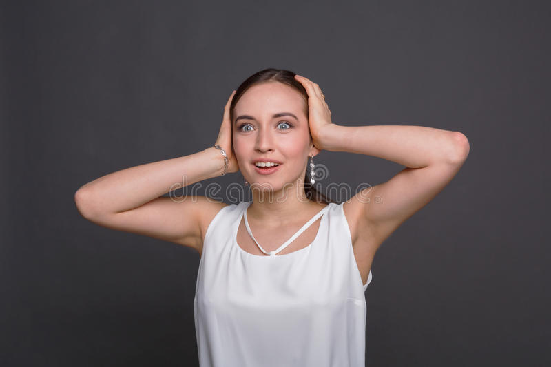 Shocked happy woman with touching her head stock photo