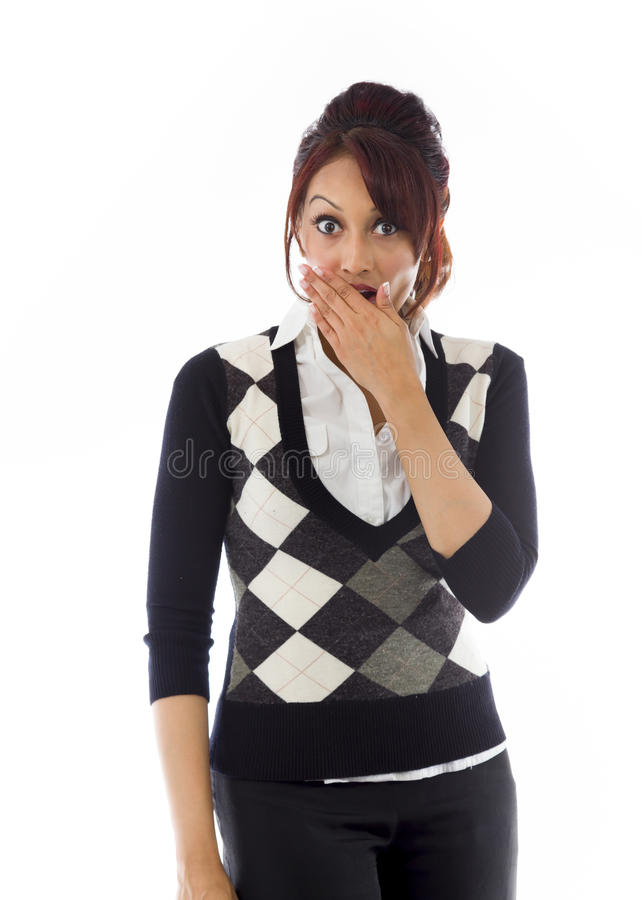 Shocked Indian young woman with hand over mouth isolated on white background royalty free stock photography