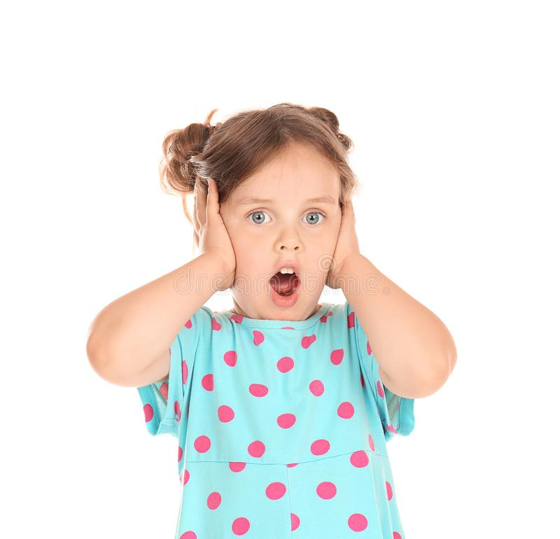 Shocked little girl covering ears with hands on white background royalty free stock photography