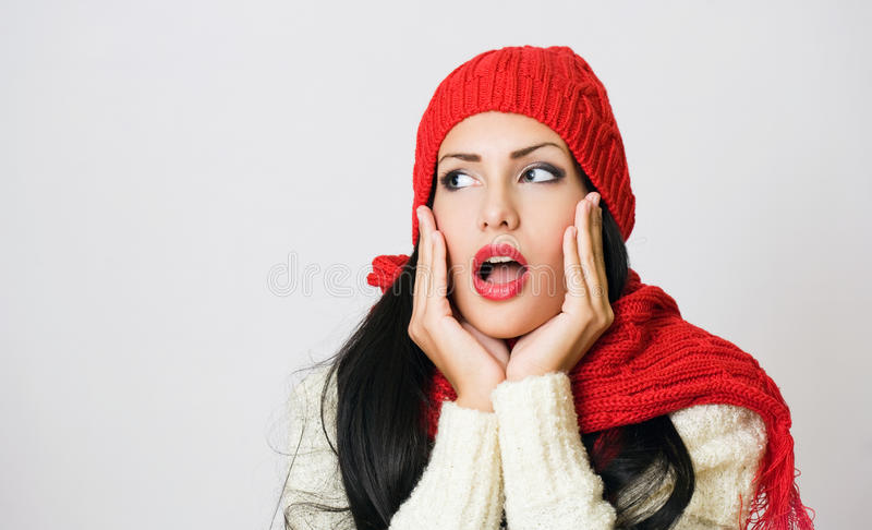 Shocked looking gorgeous brunette. stock photo