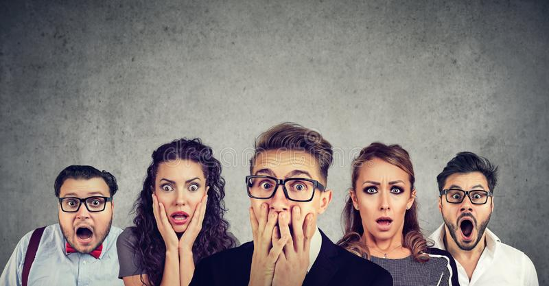 Shocked man in glasses and his scared friends stock image