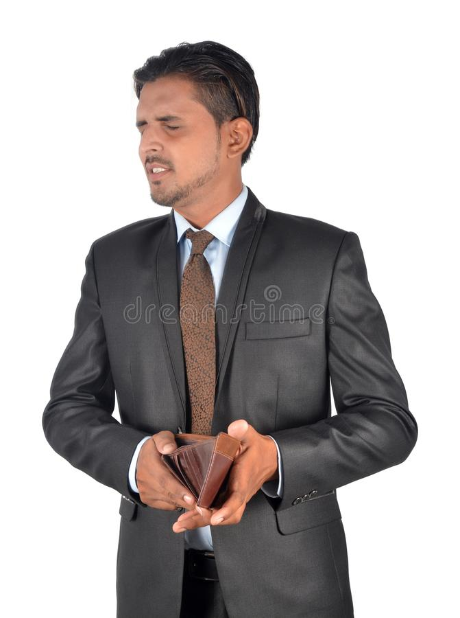 Shocked man with his empty leather wallet has no money isolated stock photography