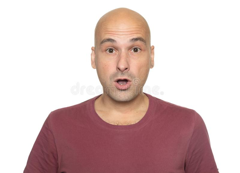 Shocked middle aged bald man isolated on white royalty free stock images
