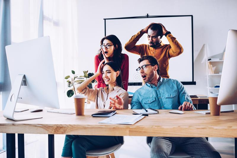 shocked multiracial business team working on project together royalty free stock photography