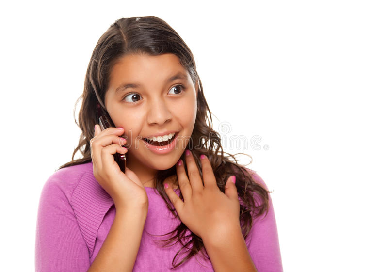 Shocked Pretty Hispanic Girl On Cell Phone stock photography