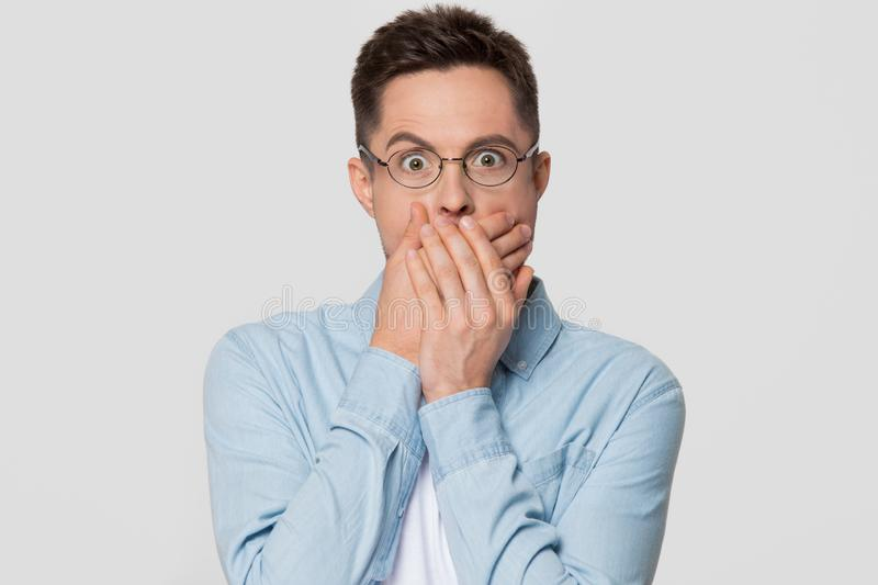 Shocked scared man with surprised face covering mouth with hands stock photos