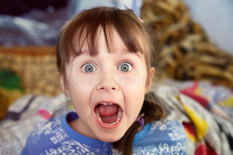 Shocked screaming little girl stock image