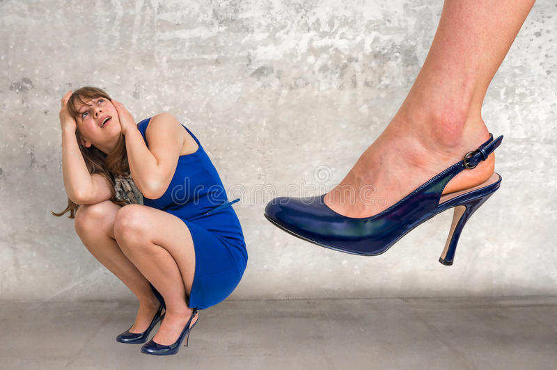 Shocked small business woman under boss pressure stock photography