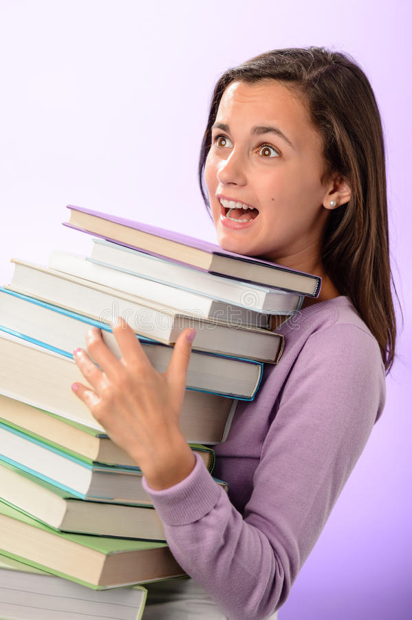 Shocked Student Girl Carry Stack Of Books Stock Photo