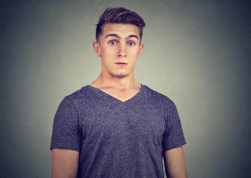 Shocked stunned young man in full disbelief royalty free stock photography