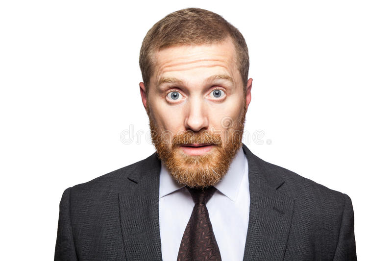 Shocked surprised businessman looking at camera with big eyes. royalty free stock photography