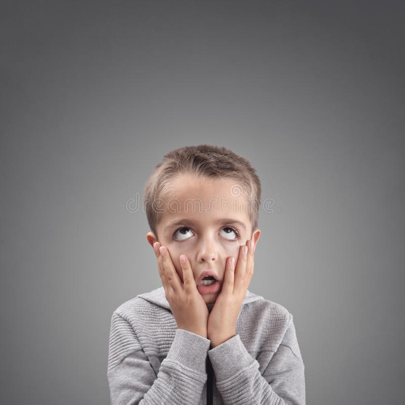 Shocked and surprised child fed up, bored or showing despair stock photography