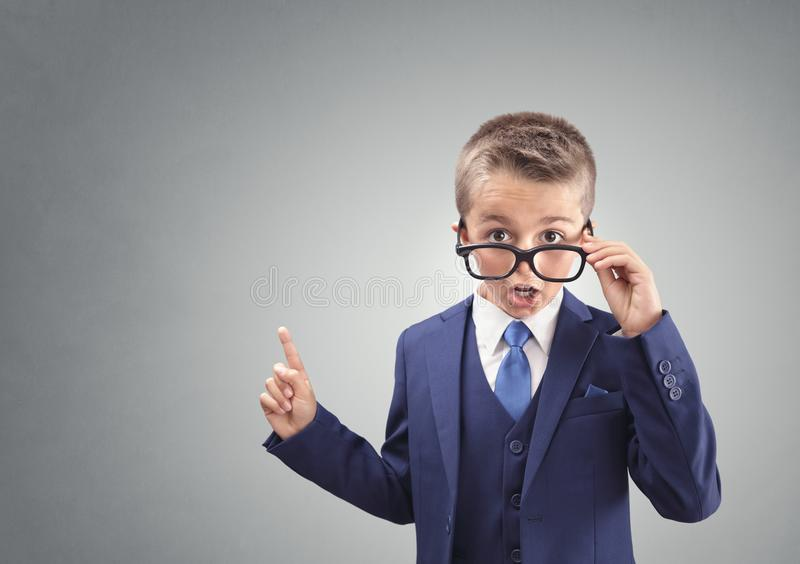 Shocked and surprised young confident executive businessman boy stock photos