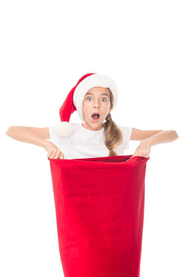Shocked teenager with Christmas bag royalty free stock photos