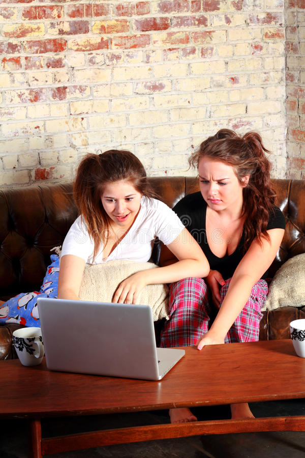 Shocked teens while networking royalty free stock images