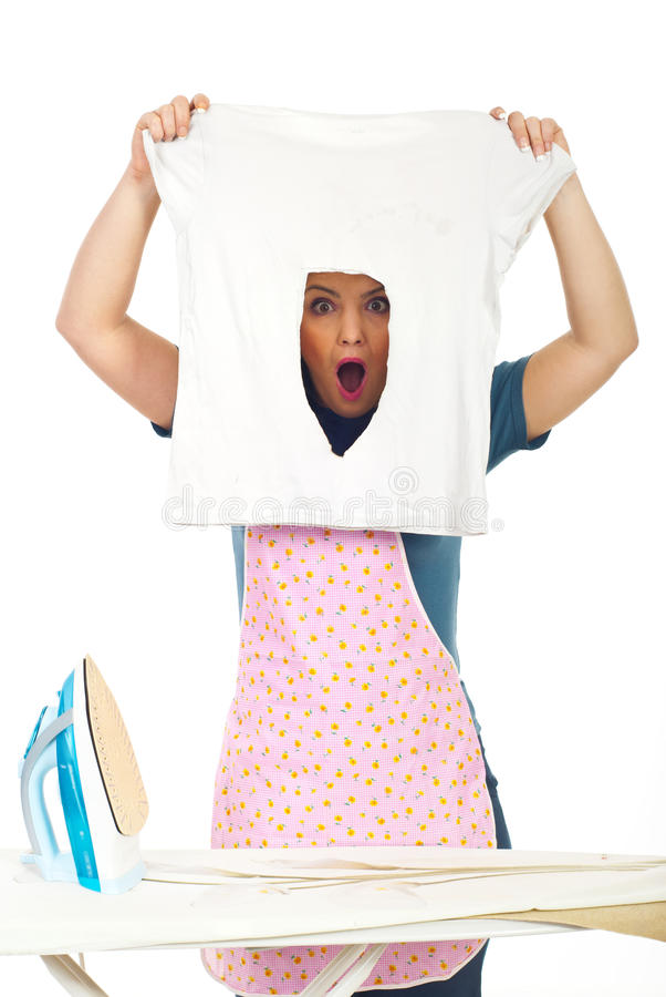 Shocked woman with burned iron shirt stock image