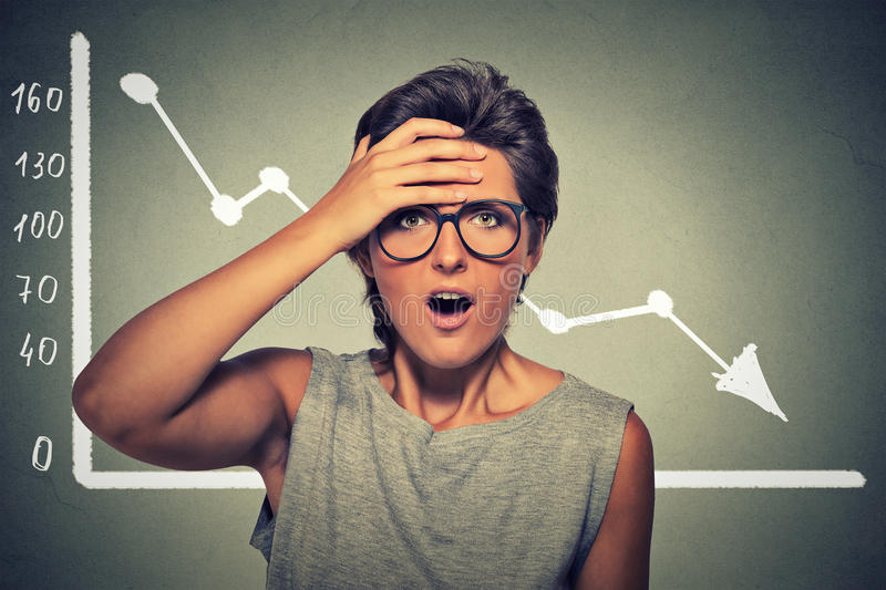 Shocked woman with financial market chart graphic going down stock photo