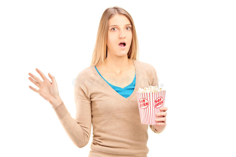 Download Shocked Woman Holding A Box Of Popcorn Stock Photo - Image: 39422629