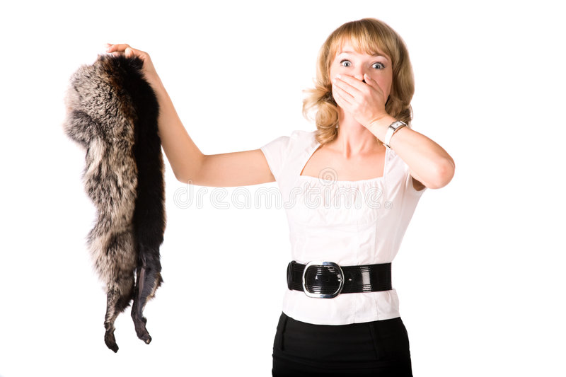 Shocked woman holding fur skin