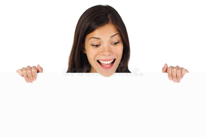 Shocked woman holding sign stock photos